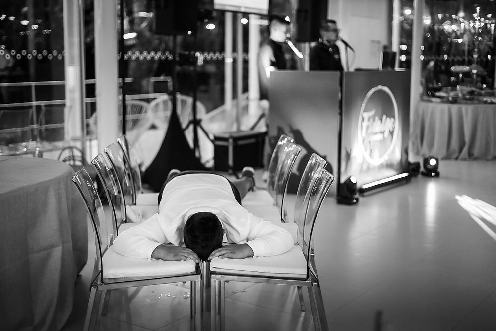 Kid sleeps on dancefloor