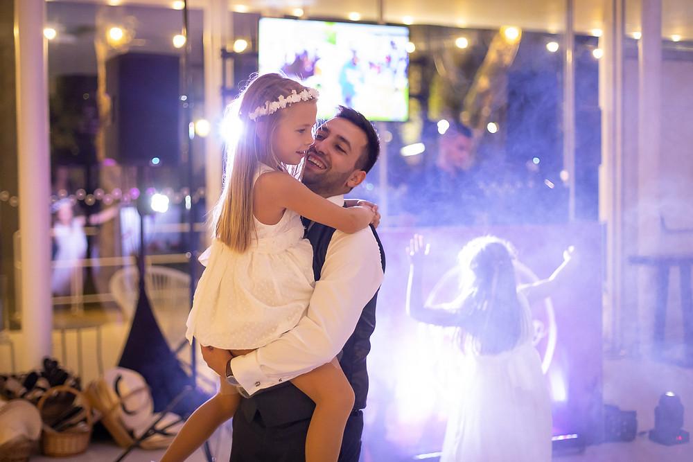 groom dances with flowergirls