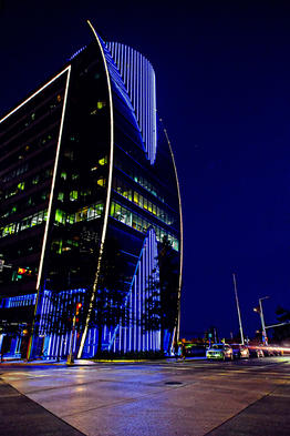 Building in dowtown Dallas that comes to life at night with its arrey of lights.