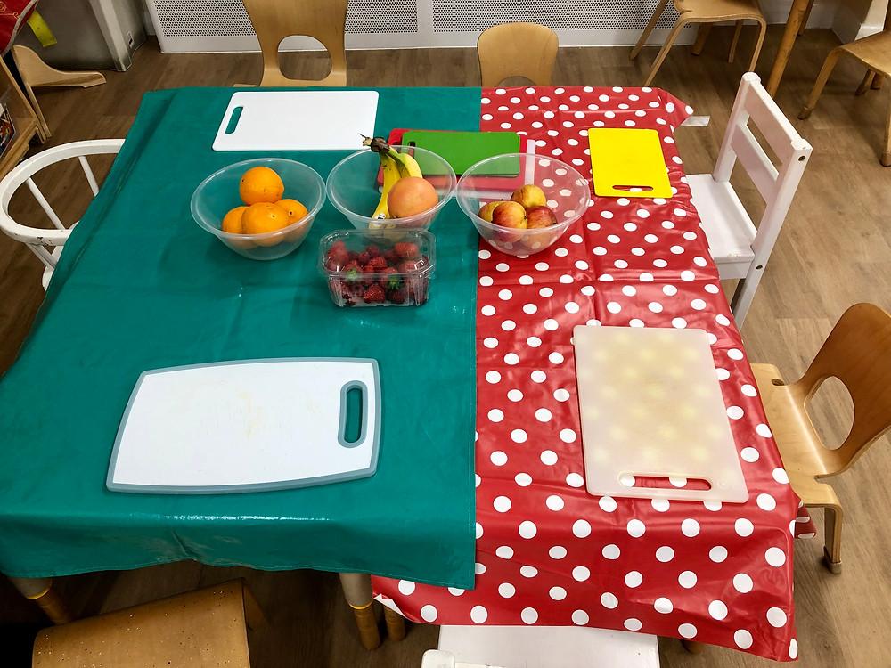 Strawberries, raspberries, bananas, apples, oranges and a grapefruit