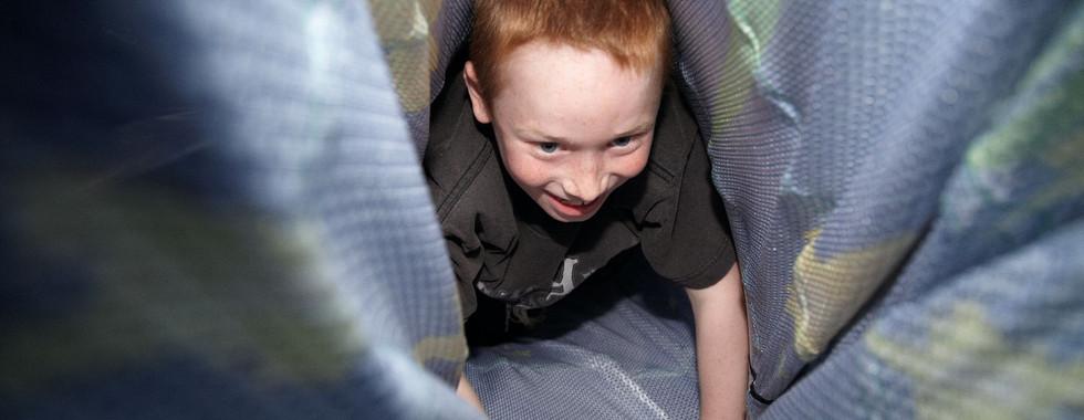 Crawling through a fabric tunnel