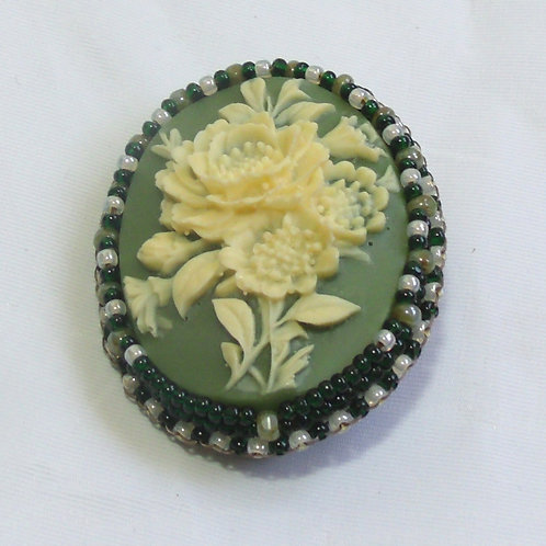 Pearl Rose cameo brooch on sage green