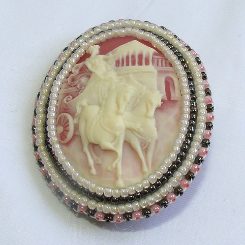 Roman Woman Driving a Chariot cameo brooch on coral