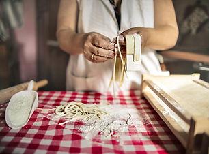 crop-cook-preparing-noodles-in-kitchen-3