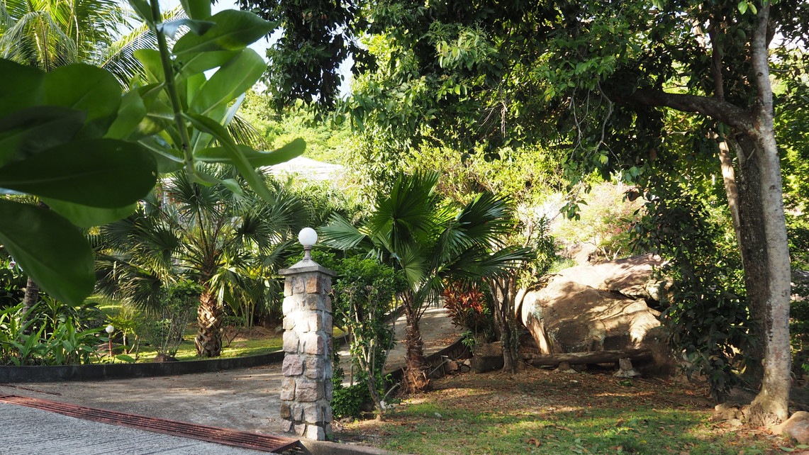 Private Driveway exit, well kept land and extensive gardens hide the villa from view