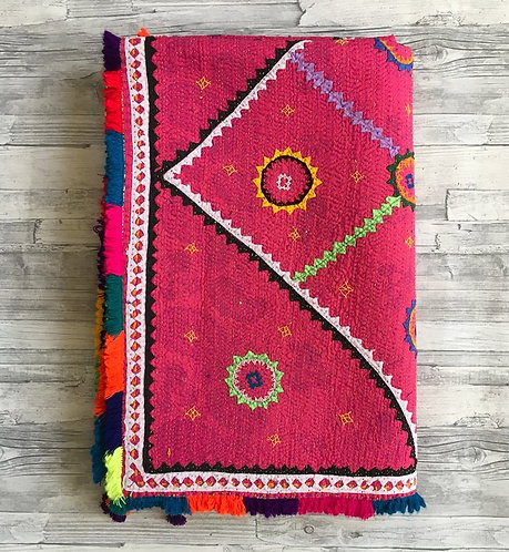 Pink Pakistani Ralli quilt with fringed border