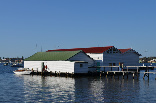 Green and Red and Orange Boat shed