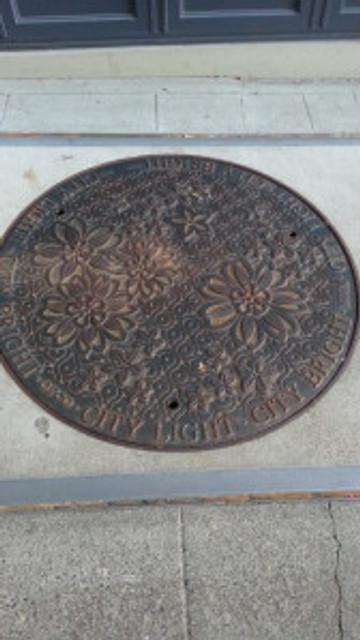 picturesque manhole cover