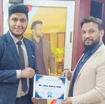Mr. Ismail handing over RCIC Agent Certificate to Mr. Abu Bakar