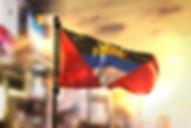 antigua-barbuda-flag-against-city-blurre