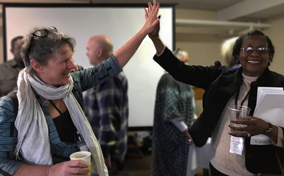 Jean Larson and Retha Spencer highfiving at the 2019 Tornadoes Citizen's Climate Education Conference in Fort Smith.