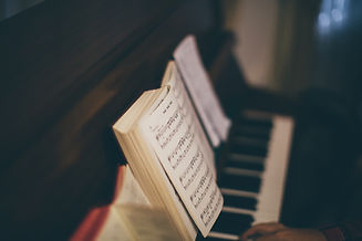 Sheet Music Over Piano