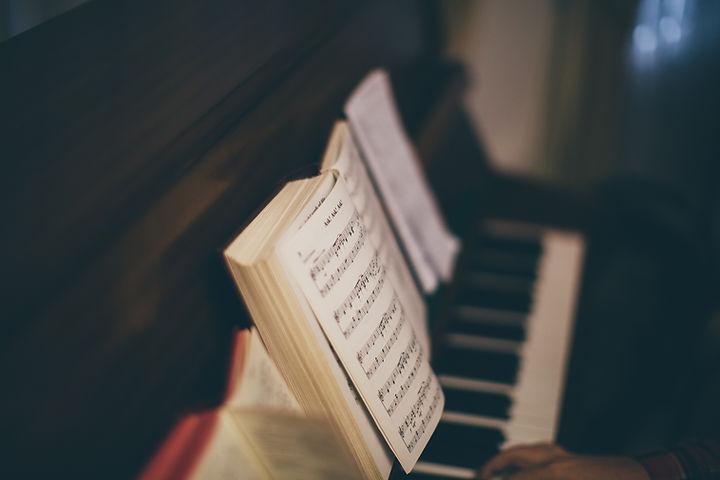 Sheet Music Over Piano