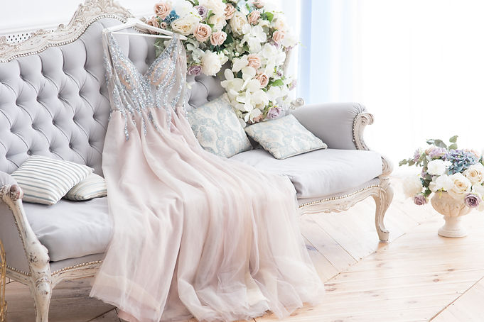 Bridal pink dress gown on the grey class