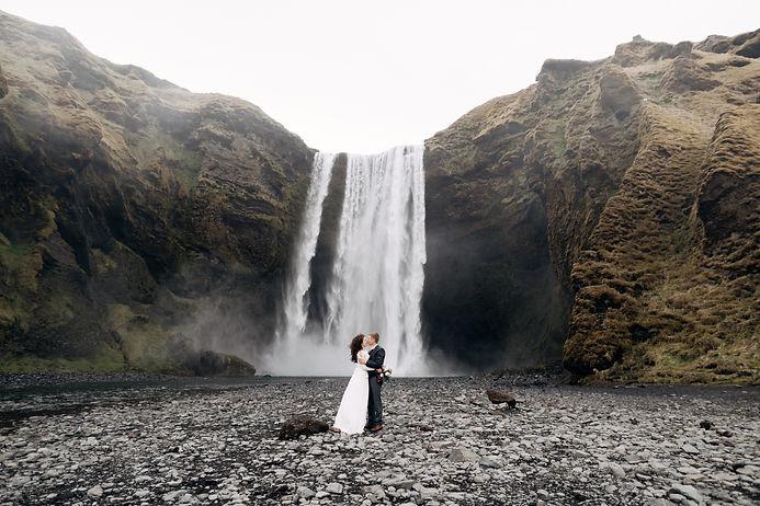 Wedding couple near Skogafoss waterfall.