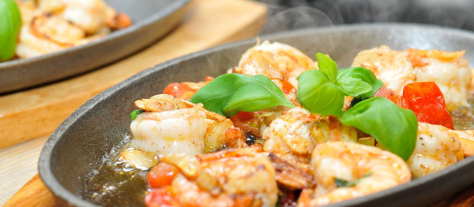 Prawns with garlic butter and cherry tomatoes.  Quick and easy!