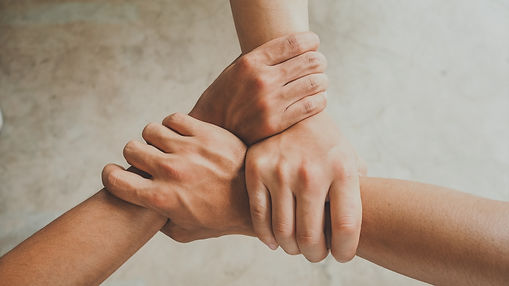 Three human join hands together backgrou