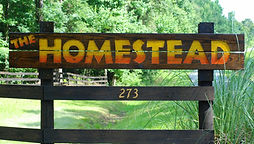 Homestead T-shirts driveway sign