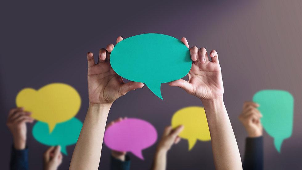 people-holding-speech-bubbles.jpg
