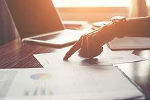 businessman-pointing-finger-analyzing-statistics-financial-graph.jpg