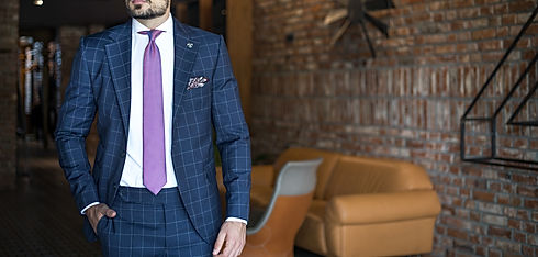 Man in expensive custom tailored suit po