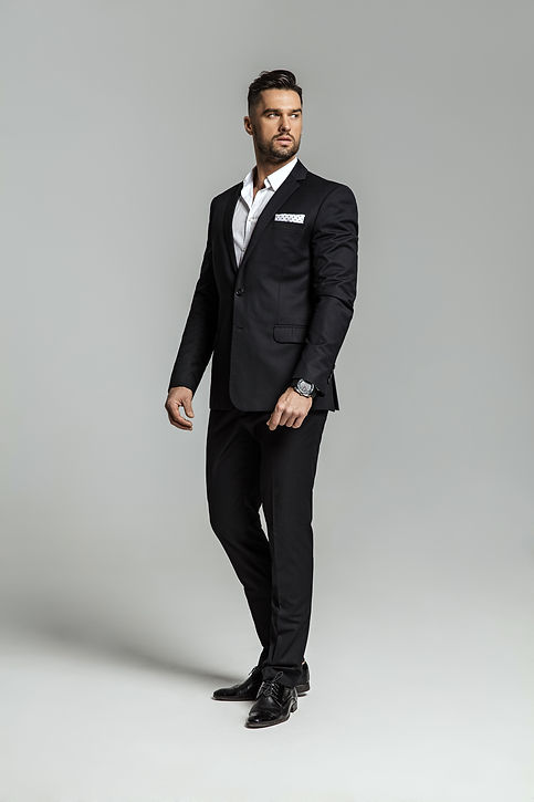 Portrait of handsome man in black suit.j