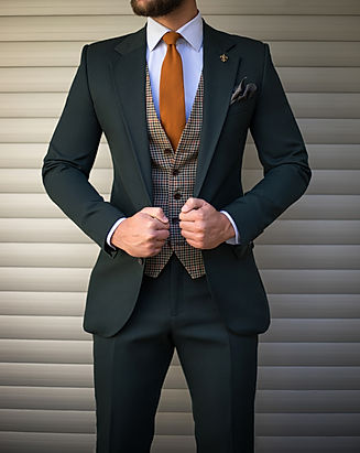 Attractive man in tailored suit posing i