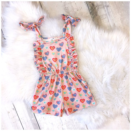 Pink Multi Colored Heart Romper with Adjustable Tie Strap by Pete & Lucy