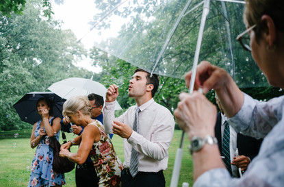 blowing bubbles after a wedding ceremony in Ottawa at the Arboretum. Photo by Melanie Mathieu, Ottawa Gatineau photographer.