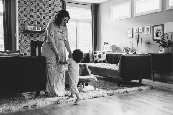 ottawa gatineau family photographer, mom dancing with daughter during in-home family photo session in Ottawa, westboro