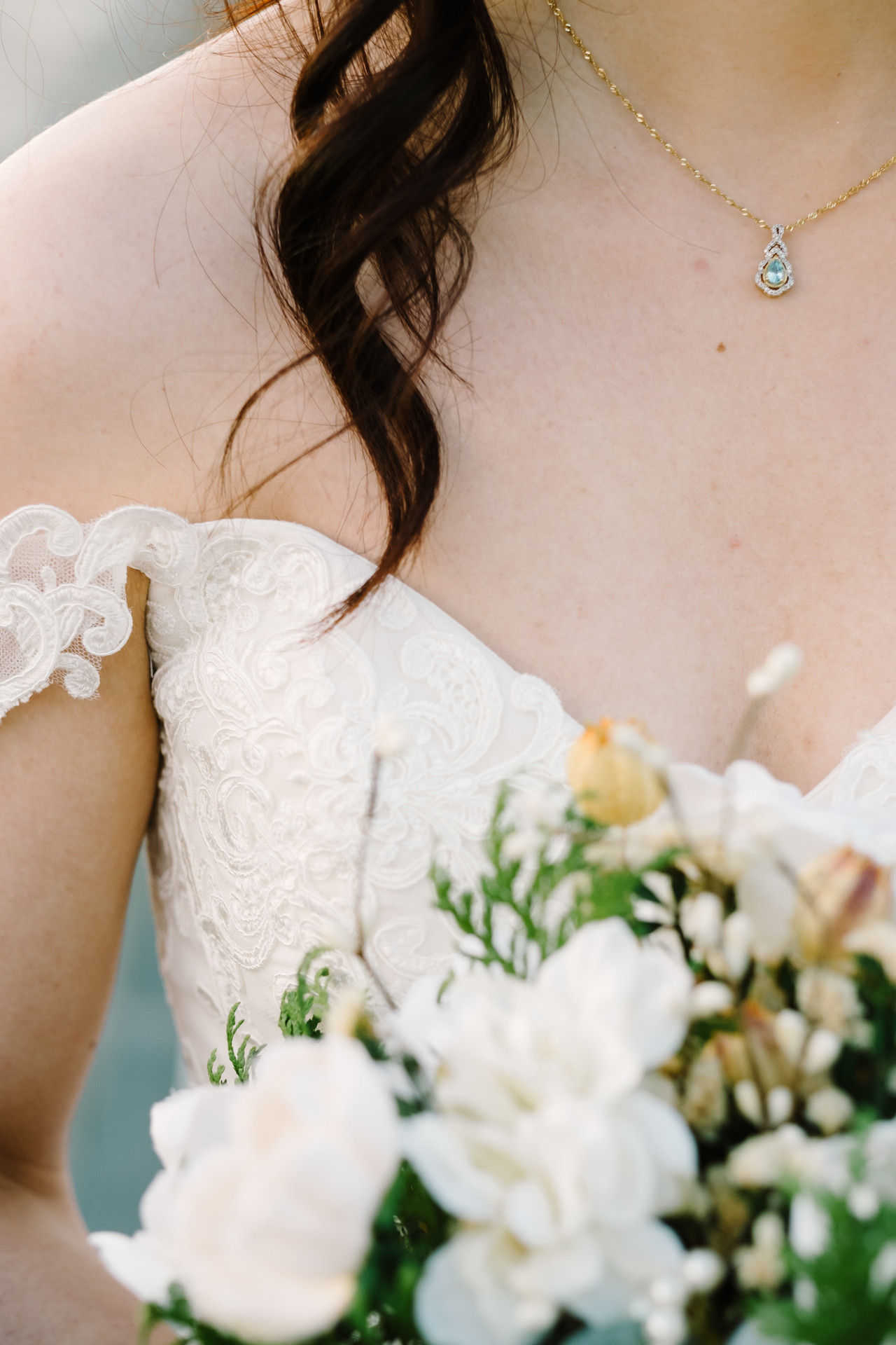 Detail photo of bride taken outside of the Chateau Laurier in Ottawa following her Fall wedding.