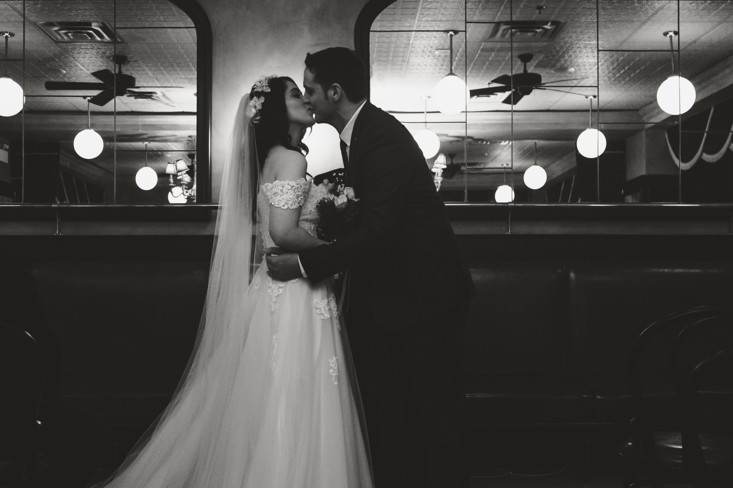 First kiss as husband and wife during intimate wedding ceremony downtown Ottawa at the Metropolitain Brasserie. Photo by Ottawa Gatineau wedding photographer Melanie Mathieu.