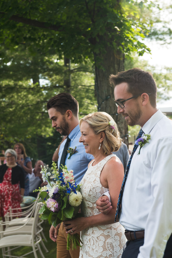 Bride and sons walking down the aisle