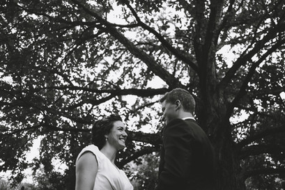 Bride and groom exchanging vows under a tree at the Arboretum in Ottawa. Photo by Melanie Mathieu, Ottawa Gatineau wedding and family photographer. Melanie focuses on candid and documentary style photography.