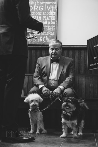 Father of the groom with dogs