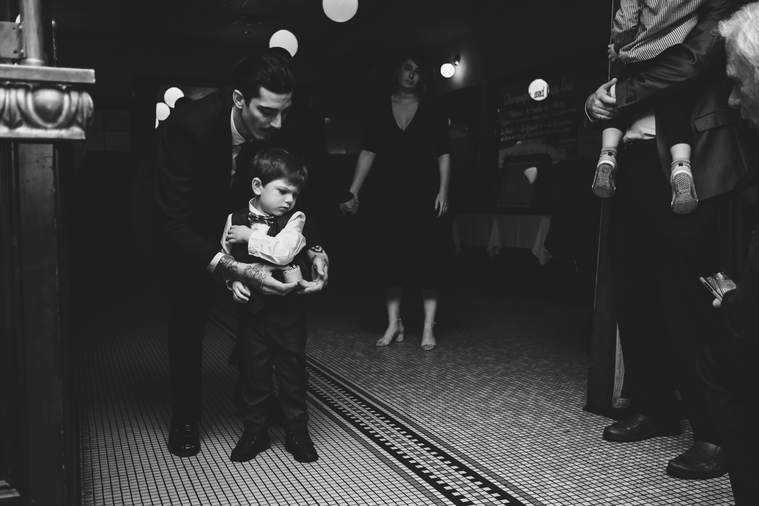 Ring bearer at wedding ceremony downtown Ottawa at the Metropolitain Brasserie.