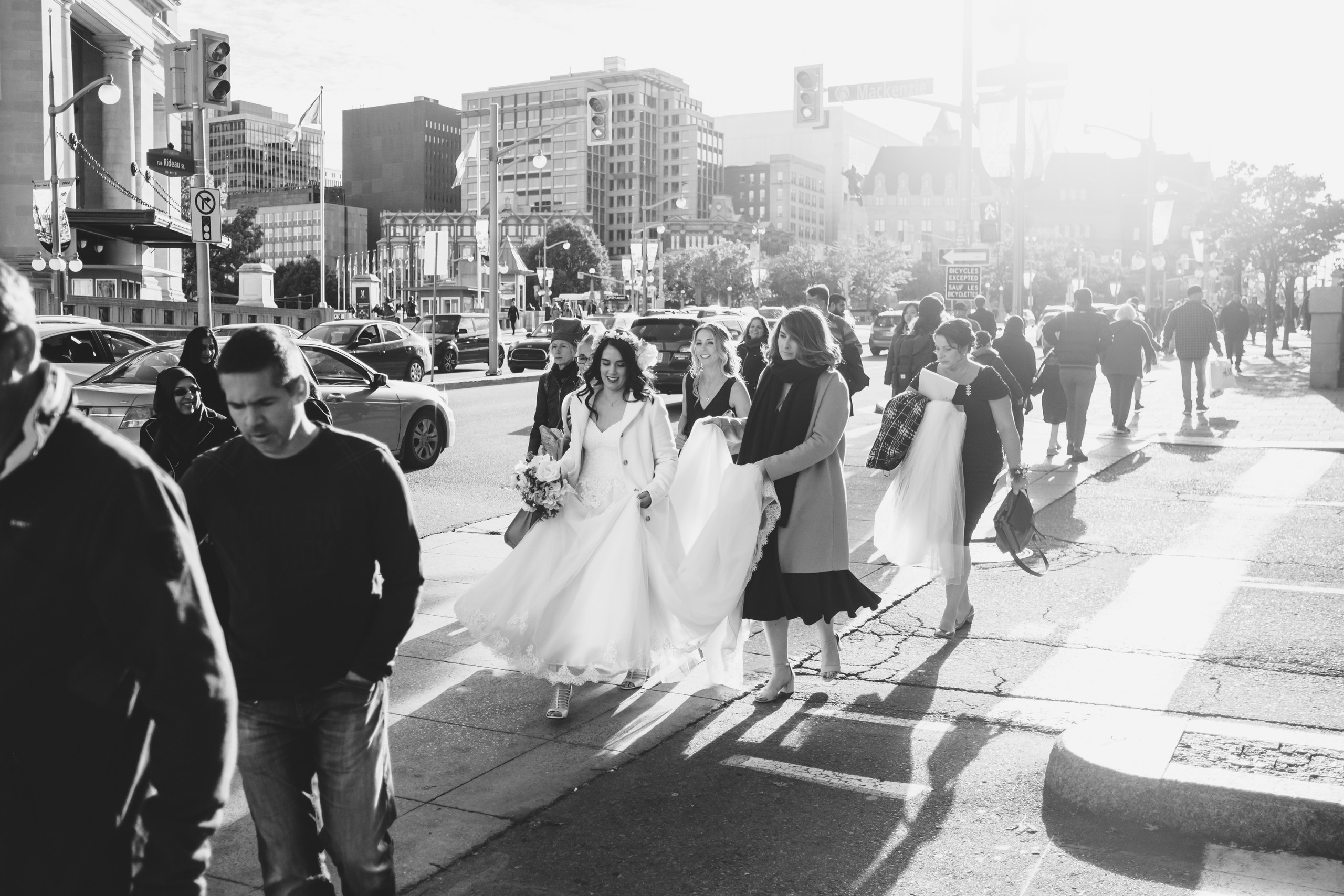 Bride crossing the street on Rideau St in Ottawa headed for her wedding ceremony at the Metropolitain Brasserie.