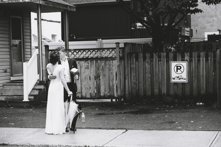 Bride and groom kissing in Little Italy after wedding ceremony at the Arboretum.