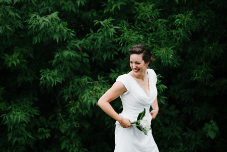 Bride smiling at the Ottawa Dominion Arboretum. Photo by Melanie Mathieu, ottawa wedding and family photographer.
