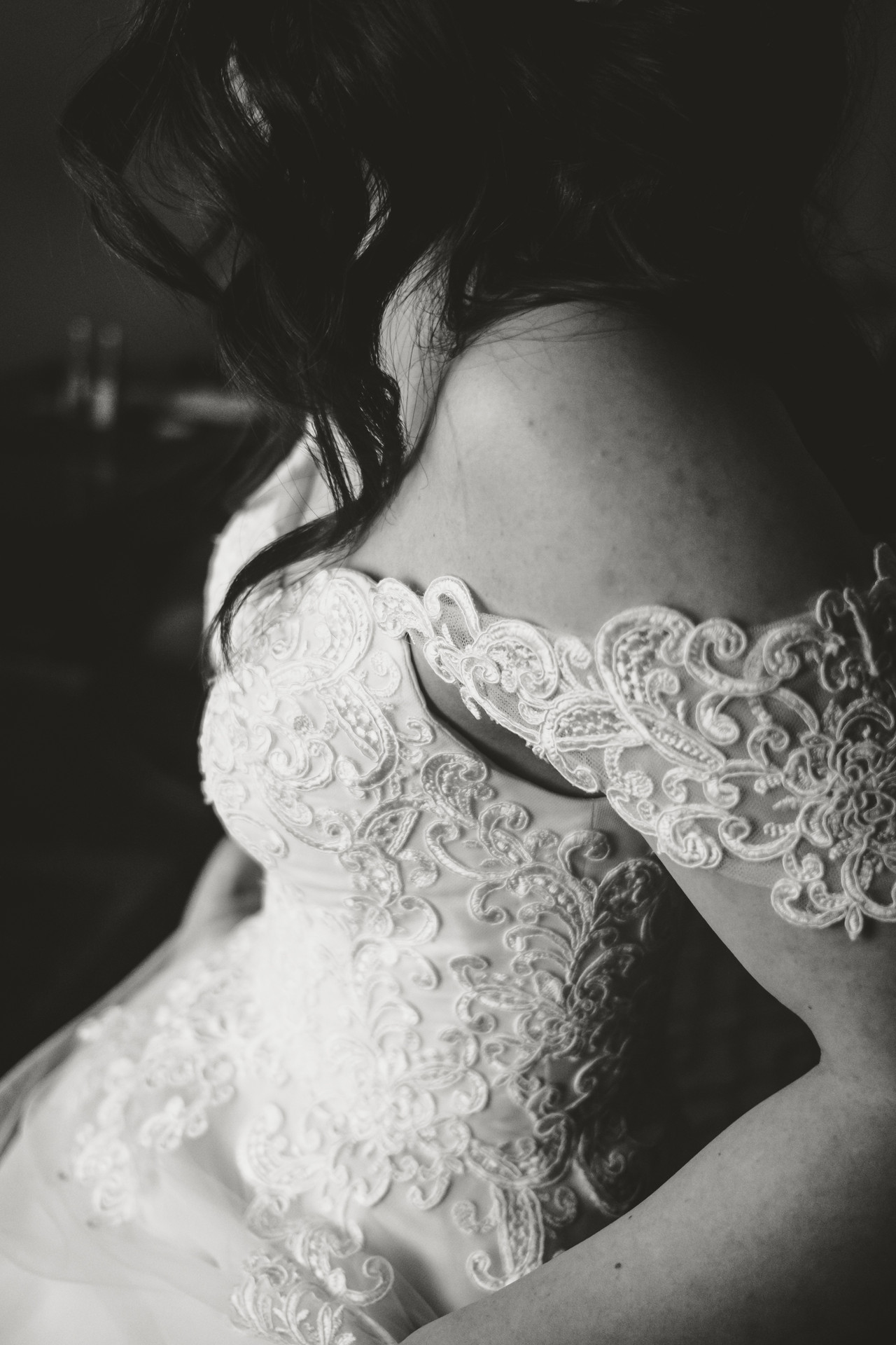 Detail of bride's dress taken at the Chateau Laurier in Ottawa prior to her wedding at the Metropolitain Brasserie.