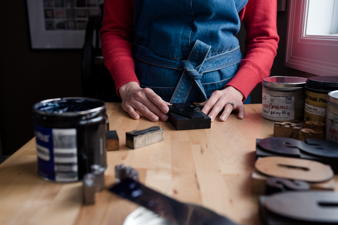 Do what you love by Melanie Mathieu Photography featuring Impressus. Lifestyle and documentary photography Ottawa Ontario. Business portraits. Featuring owner using antique letterpress to hand print cards.