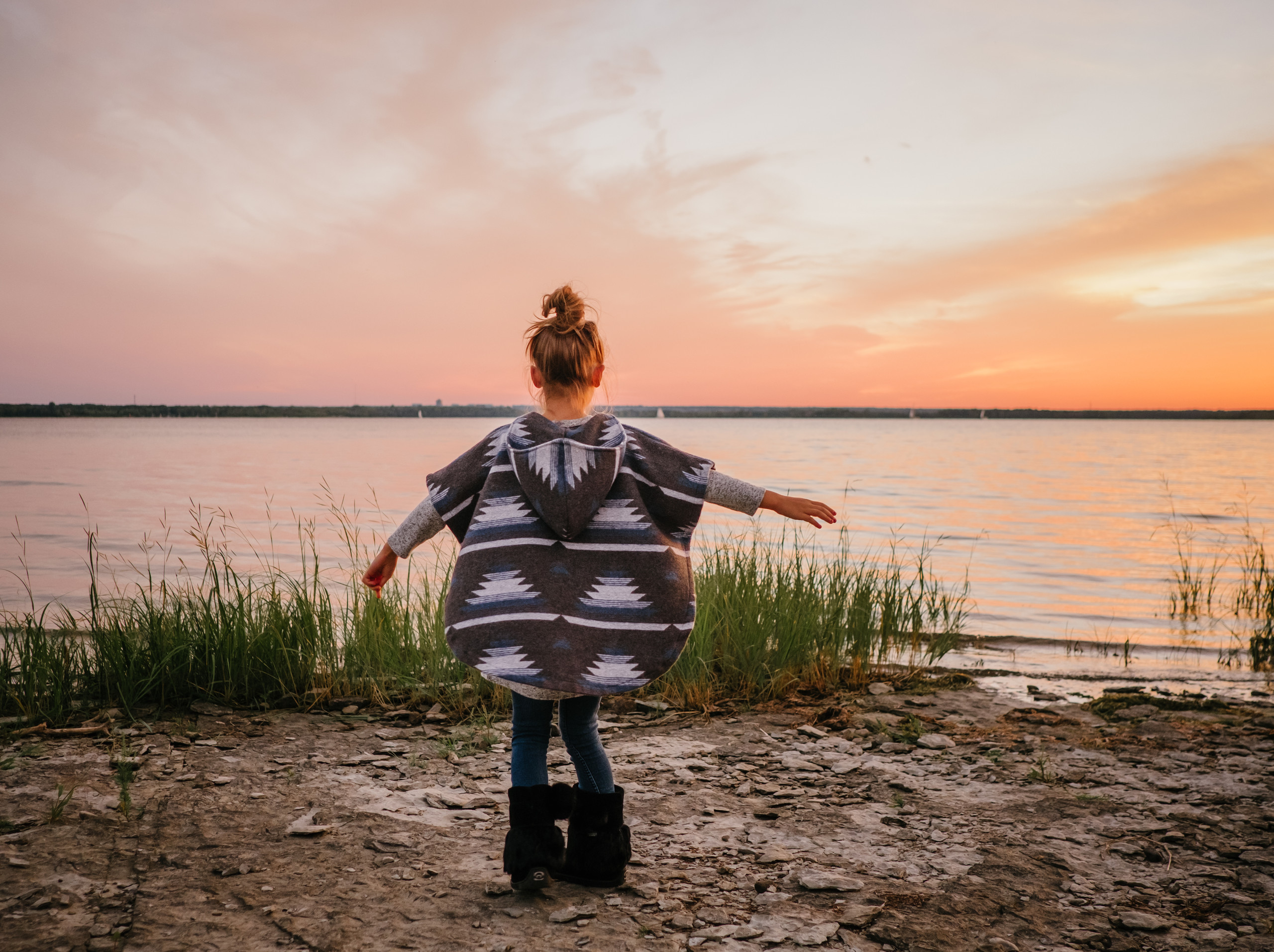 Ottawa Gatineau lifestyle, branding and family photographer captures girl in Mini Tipi poncho during branding photo session in Aylmer QC. Melanie is a local photographer creating imagery for small businesses.