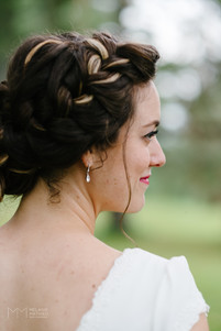 Details of bride on her wedding day at the Ottawa Arboretum following an outdoor ceremony.