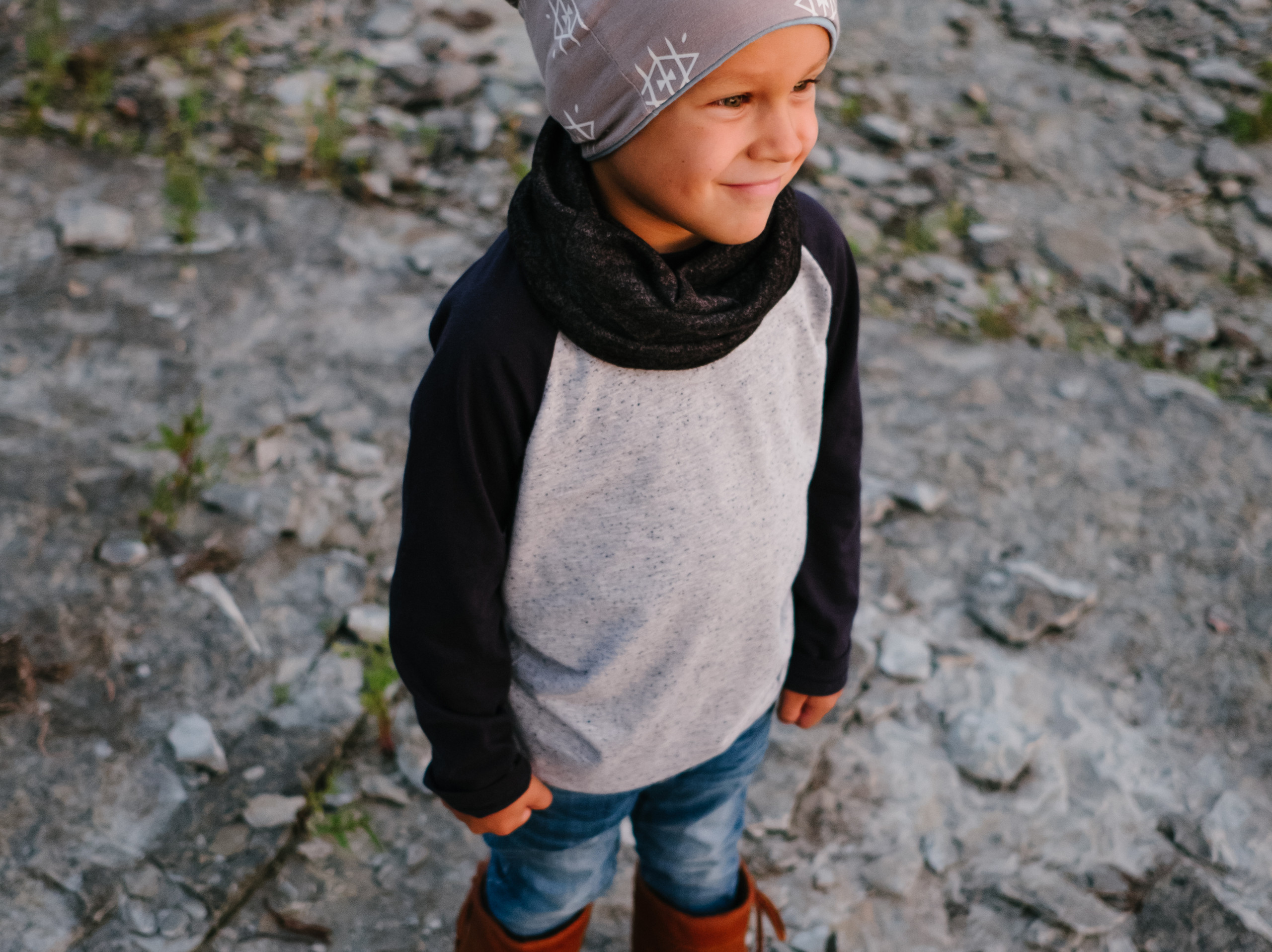 Portrait of a boy wearing a Mini Tipi beanie during branding photography session with Melanie Mathieu Photography. Melanie is a lifestyle, branding and family photographer in Ottawa Gatineau.
