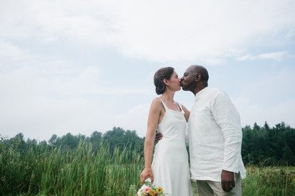 bride and groom kissing following wedding ceremony at a farm in Gatineau QC.