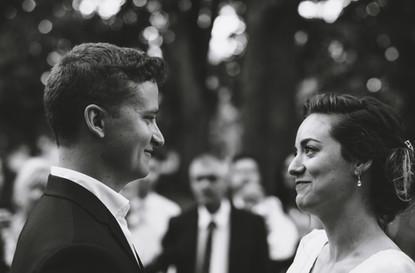 Bride and groom smiling during Ottawa wedding ceremony. Photo taken at the Arboretum by Melanie Mathieu, Ottawa photographer.