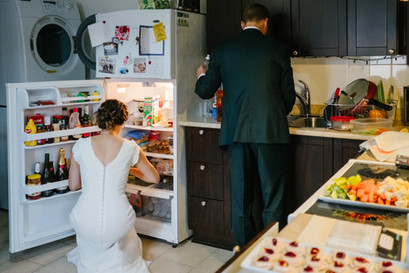 Couple in their kitchen on their wedding day, preparing for guests. Photo by Ottawa wedding photographer Melanie Mathieu Photography +Films.