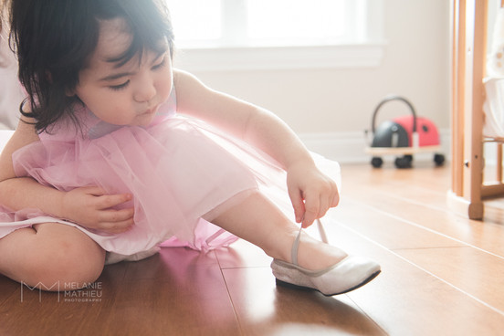 Girl putting on party shoes