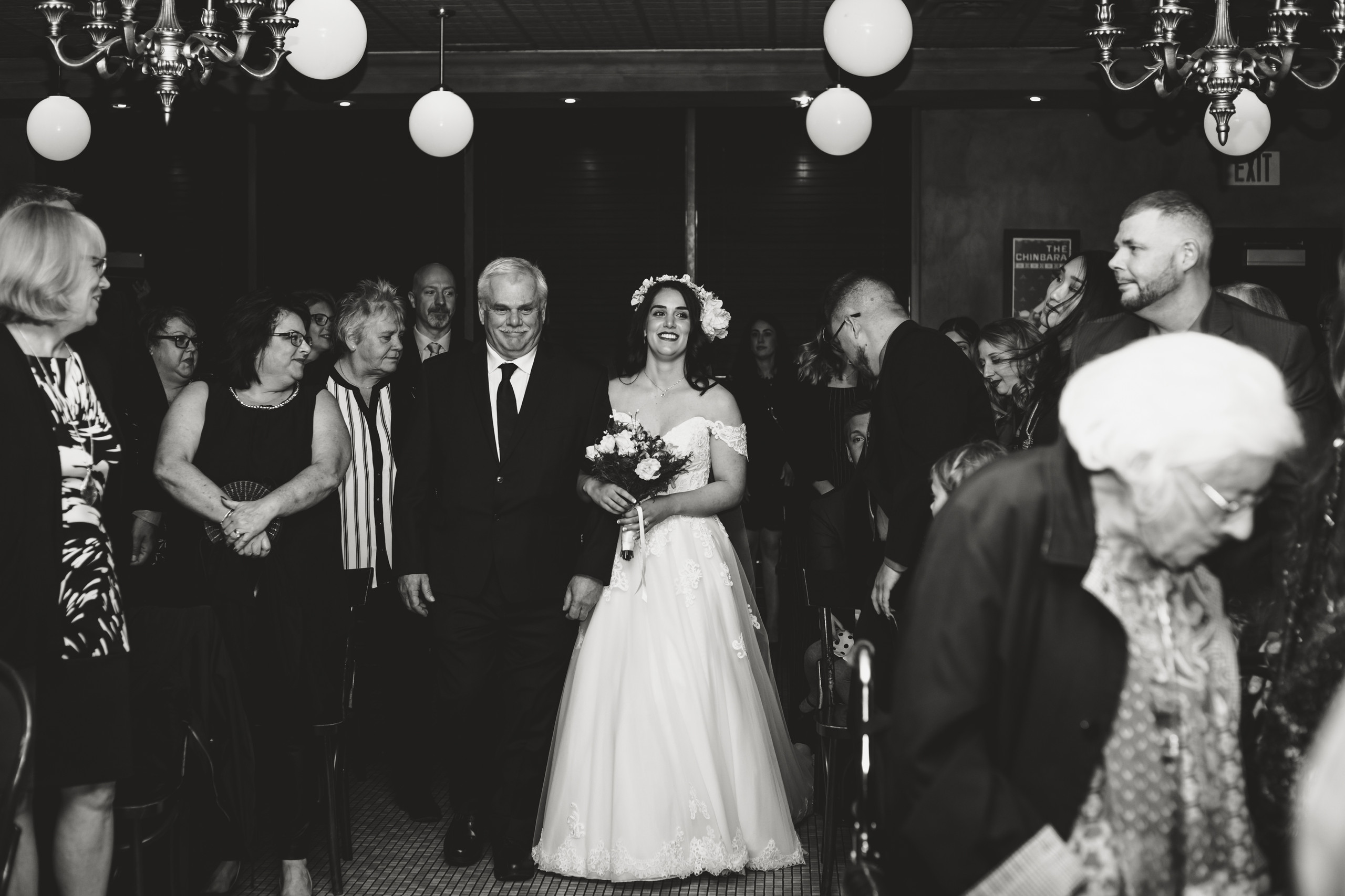 Bride walking down the aisle with her father at an intimate wedding ceremony at the Metropolitain Brasserie.