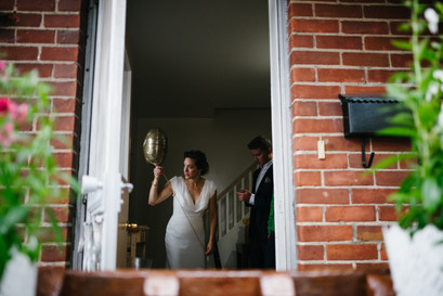Bride in doorway looking out the window before the outdoor wedding ceremony at the Ottawa Arboretum.  Photo by Melanie Mathieu Photography, Ottawa Gatineau photographer focusing on candid and documentary photography.